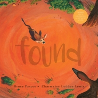 Found book cover featuring a small animal looking lost on the red dirt.